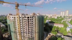 Tall cranes work on construction site of residential complex Stock Footage