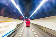 Red english bus in a tunnel in hongkong Stock Photos