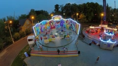 People prepare to ride on Shake Dance amusement in park Stock Footage