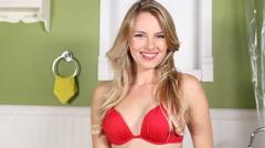 Sexy bikini girl portrait smiling and flirting indoors Stock Footage