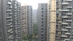 Apartment buildings in a second tier city in China Stock Footage