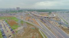 Cityscape with construction site of overpass and traffic Stock Footage