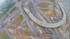 Transport ride by beltway near construction site of overpass Stock Footage