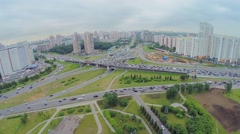 Townscape with transport traffic on interchange at spring Stock Footage