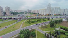 Transport congestion on interchange at spring cloudy day. Stock Footage