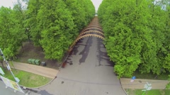 Alley with arc tunnel in park Sokolniki at spring day. Stock Footage