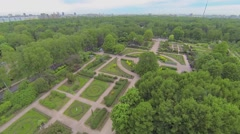Park with rosarium and megalopolis on horizon at spring Stock Footage