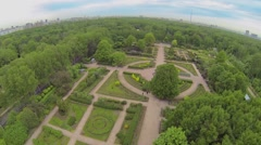 Park with rose garden and megapolis on horizon at spring - stock footage