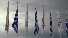 National and Olympic flags near Panathenaic Stadium in Athens, Greece Stock Footage