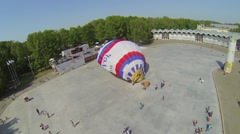 Stock Video Footage of People watch air balloon inflation on square of park
