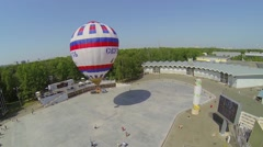 Air balloon with inscription Saint Russia flies above square Stock Footage