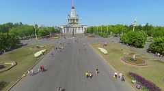 People walk by main alley of All Russia Exhibition Complex Stock Footage