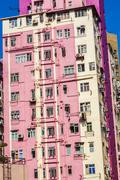 Facade of houses downtown kowloon with appartments and air condition Stock Photos