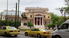Road traffic near statue of General Theodoros Kolokotronis in Athens, Greece Stock Footage