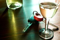 Ignition key and hard liquer Stock Photos