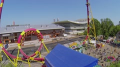 People ride on Cobra amusement in park of VVC at spring Stock Footage