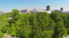 Cityscape with pond in public garden at sunny spring day. Stock Footage