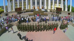 Lot of people watch performance with military orchestra - stock footage
