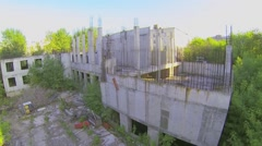 Unfinished construction at sunny spring day. Aerial view Stock Footage