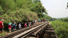 People on old railroad near Kwai river in Thailand Stock Footage