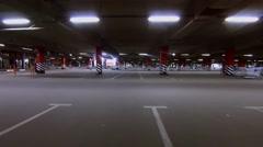 Large underground garage with illumination. Aerial view - stock footage