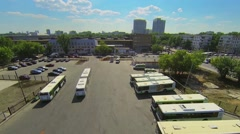 Urban transport station on street with traffic at spring Stock Footage