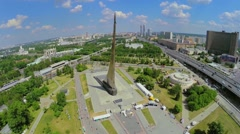Megapolis panorama with Obelisk Conquerors of Space, ferris wheel - stock footage