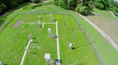 Fenced grass area with equipment of meteorological station Stock Footage