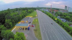 Petroleum station near highway with traffic at summer Stock Footage