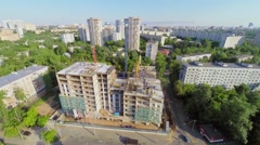 Cityscape with traffic on street near construction site Stock Footage