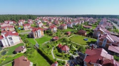 Gated development near forest at sunny summer day. Aerial view Stock Footage