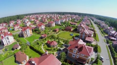 Cottage settlement near forest at sunny summer day. Aerial view Stock Footage