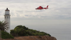 Coast Guard Helicopter At Lighthouse Stock Footage