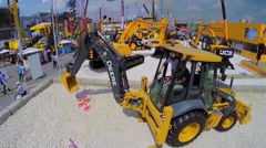 John Deere and JCB machines on Specialized Exhibition Stock Footage