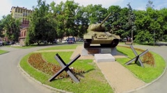 Monument of tank T-34 near residential complex at summer Stock Footage