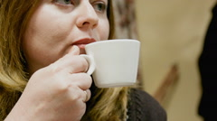 Woman drink a coffee Stock Footage