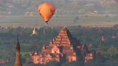 Ballons at sunrise flying over Bagan Myanmar, Asia 005 Stock Footage