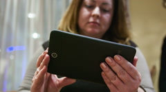 Woman looking at the tablet Stock Footage