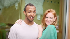 Portrait of young couple in front of shop window Stock Footage