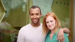 Portrait of young couple, man has his arm around redheaded woman Stock Footage