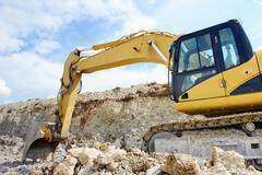 limestone quarry with earth mover - stock photo
