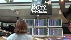 Departure screens and Madrid duty free - stock footage