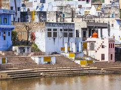 Pilgrims take ritual bathing in holy lake on in pushkar Stock Photos