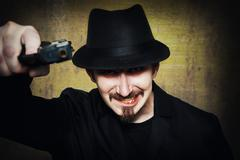 Grunge portrait of an insane gangster - stock photo