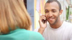 Man on coffee date hangs up his cell phone Stock Footage