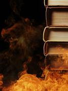 Stack of books in a burning fire Stock Photos