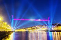 hanging bridge between portugalete and getxo with celebration lighting - stock photo
