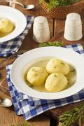 hot homemade matzo ball soup - stock photo