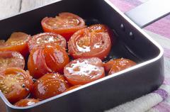Pan with grilled cherry tomatoes Stock Photos