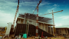 4K construction site timelapse with cranes and machinery Stock Footage